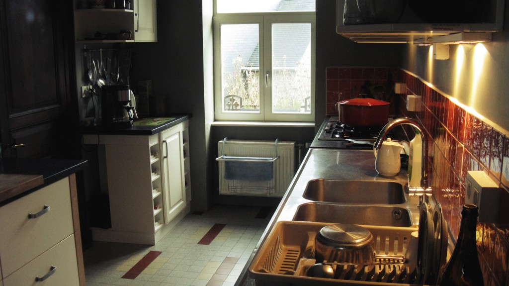 Well equipped renovated kitchen which has retained much of the original character.
